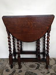 dark wood drop leaf table dark wood drop leaf table barley twist gate legs circa 1930s