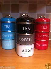 kitchen tea coffee sugar canisters monochrome stack of tea coffee and sugar storage jars kitchen
