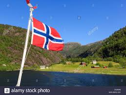 norwegian flag flying on a boat cruise sailing from mostraumen