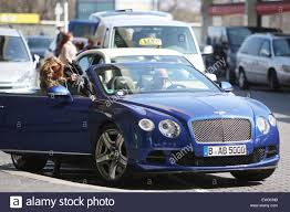 blue bentley kim gloss is picked up at tegel airport by an unidentified male in