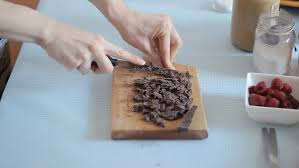 closeup video of woman u0027s hands cutting chocolate for a cake stock