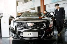 lexus gs vs cadillac xts cadillac appeals to young chinese car buyers
