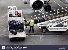 united airlines international baggage fee baggage handlers loading united airlines boeing 757 at belfast stock