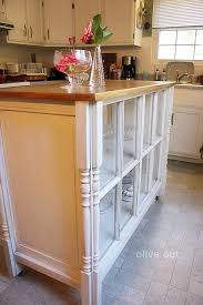 repurposed kitchen island 20 ways to repurpose windows upcycled window projects