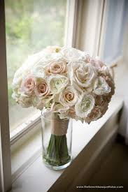 lovely bridal bouquet of light pink blush and white roses and