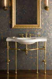 carrara marble console sink 4 leg curved console shown in brass with carrara marble sink