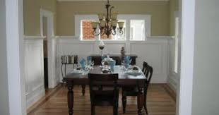 tall wainscoting for dining room with dark gray upper walls if