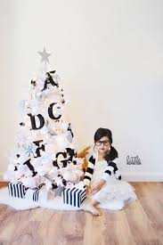 white tree with black decorations lights
