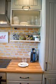 remodelaholic tiny kitchen renovation with faux painted brick
