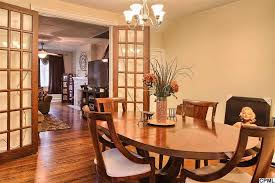 craftsman dining room with hardwood floors doors in