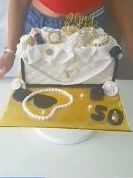 self taught baker makes handbag shaped birthday cake with one