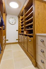 Storage Solutions Laundry Room by Bespoke Shelving And Cupboards Provide A Shoe Room And Luxury