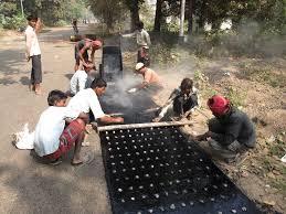 file road repairing work padmapukur water treatment plant road