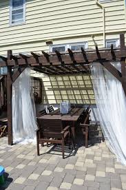 Pergola Off House by In The Little Yellow House Pergola Styling Curtains