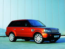 dark blue range rover red land rover range rover sport at a dark blue wall photo cars