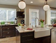 sherwin williams universal khaki white cabinets walker zanger