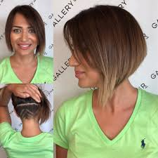 short hairstyles with side swept bangs for women over 50 women s asymmetric inverted bob with side swept bangs and undercut