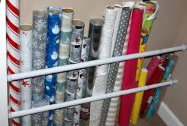 Organize Gift Wrap - creative ways to use curtain rods around the home