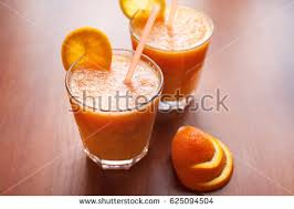 lemon orange smoothies on table slices stock photo 625094219