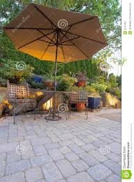 Patio Table Set With Umbrella by Garden Patio Table And Chairs With Umbrella Stock Photography