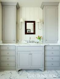 Bathroom Double Vanity Cabinets by Blue And Gray Bathroom Features A Gray Double Vanity Painted