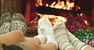 Kids Wool Socks Feet In Woolen Socks Warming By Cozy Fire In Christmas Time In