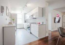 how to touch up white gloss kitchen cabinets a white ikea kitchen goes for a touch of shine