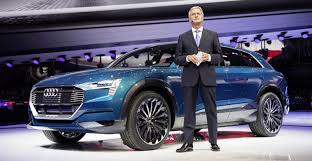 who owns audi car company audi tells dealerships to get electric vehicles because it