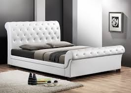 baxton studio leighlin white modern sleigh bed with upholstered