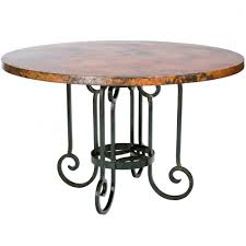 table with wrought iron base and 60