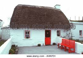 Thatched Cottage Ireland by Thatched Cottage Inis Mor Aran Isles Ireland Stock Photo Royalty