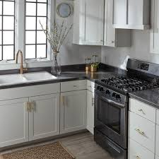 white kitchen cabinets with gold countertops black and white kitchen featuring stunning gold accents get