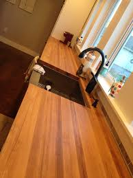 my take on butcher block countertops we could do our kitchen remodel over again i would have built my own cabinets laid pine flooring and finished it myself and made my own butcher block