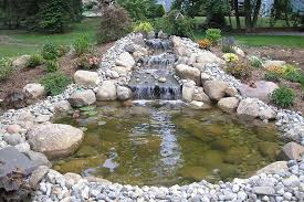 attractive small backyard waterfalls with river stone structure