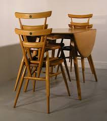 Stacking Dining Chairs by Hayloft Mid Century Ercol Green Dot Stacking Chairs And Table