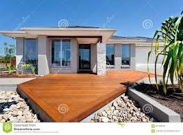 wooden yard with big rocks around a modern mansion stock photo