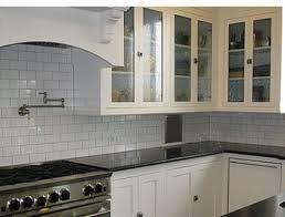 backsplash for white kitchens white subway tile back splash with white cabinets and black