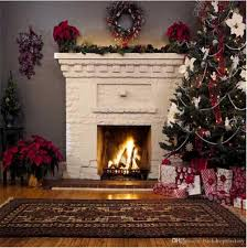 indoor white fireplace backdrop decorated green pine