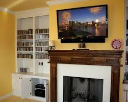 television over fireplace on wall and above fireplace flat panel lcd led plasma tv