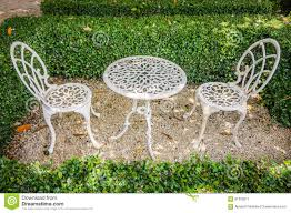 Metal Garden Table Vintage White Metal Table And Chairs In Garden Stock Photo Image