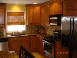 tile backsplash astounding brown oak cabinets with breakfast