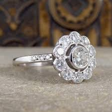 art deco style diamond flower cluster ring in 18ct white gold
