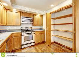 Kitchens With Wood Cabinets Kitchen With Golden Wood Cabinets And Hardwood Floor Stock Photo