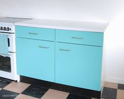what paint to use on melamine kitchen cabinets diy how to spray paint melamine kitchen cabinets