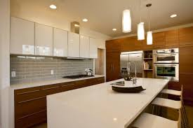 kitchen with wood cabinets trend alert mixed cabinet finishes in the kitchen
