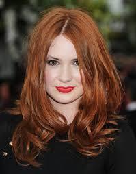 dark brown hair with golden highlights underneath popular long