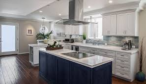 modern dark blue stained kitchen island with white marble counter