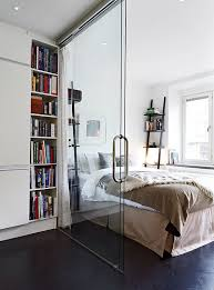 Room Divider Walls by Glass Wall Divider In A Small Apartment Separating Kitchen And