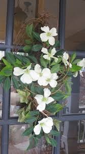 grapevine moss and dogwood easter cross for the front door