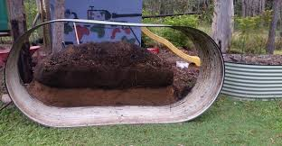 how much drainage and soil do i need in a raised garden bed
